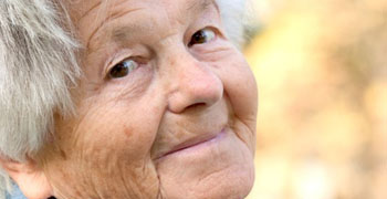 Elderly woman smiles